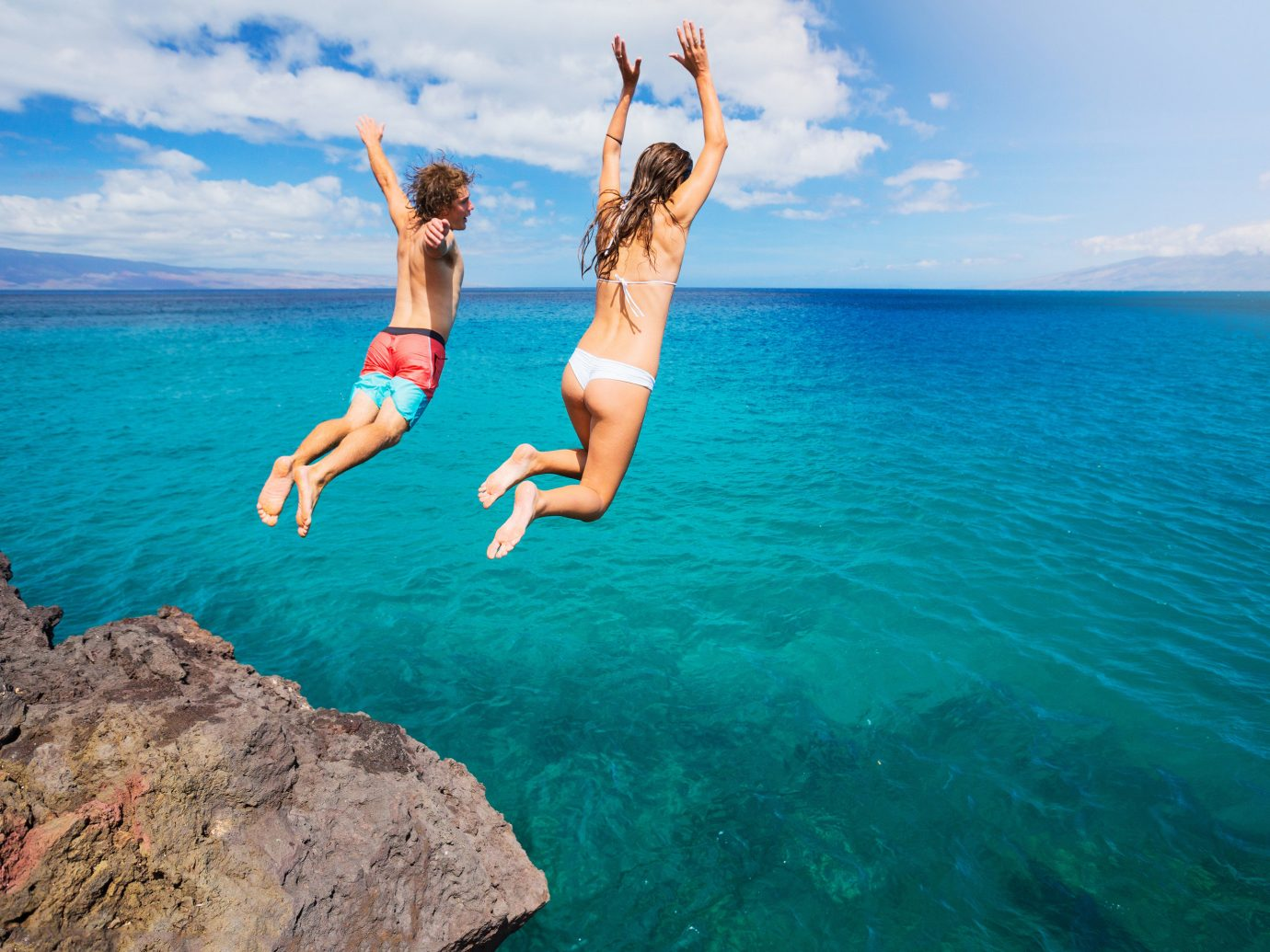 Offbeat water sky outdoor Sea Ocean vacation water sport Beach swimming Coast caribbean Nature cape bay jumping beautiful day