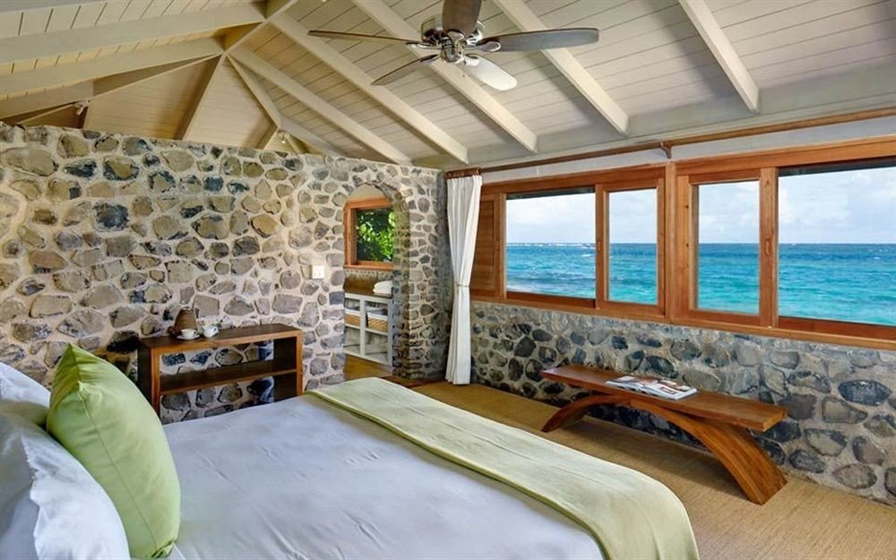 Beachfront Bedroom Hotels Luxury Resort indoor bed room property estate ceiling cottage home Villa real estate interior design farmhouse pillow living room Suite furniture