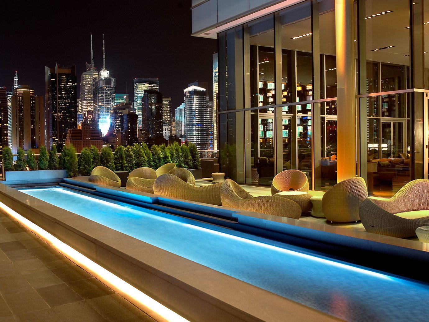 Family Travel Hotels night Lobby lighting interior design swimming pool Bar Resort restaurant