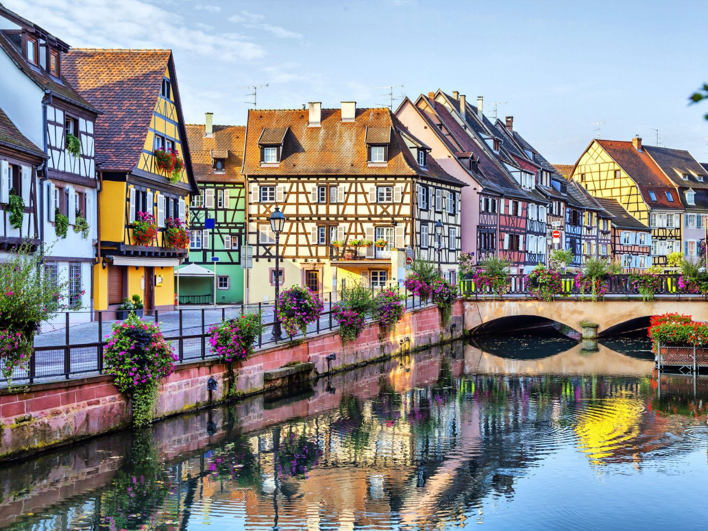 Trip Ideas building water outdoor Canal Town geographical feature landform body of water waterway cityscape neighbourhood human settlement scene house River vacation tourism Harbor Village flower several