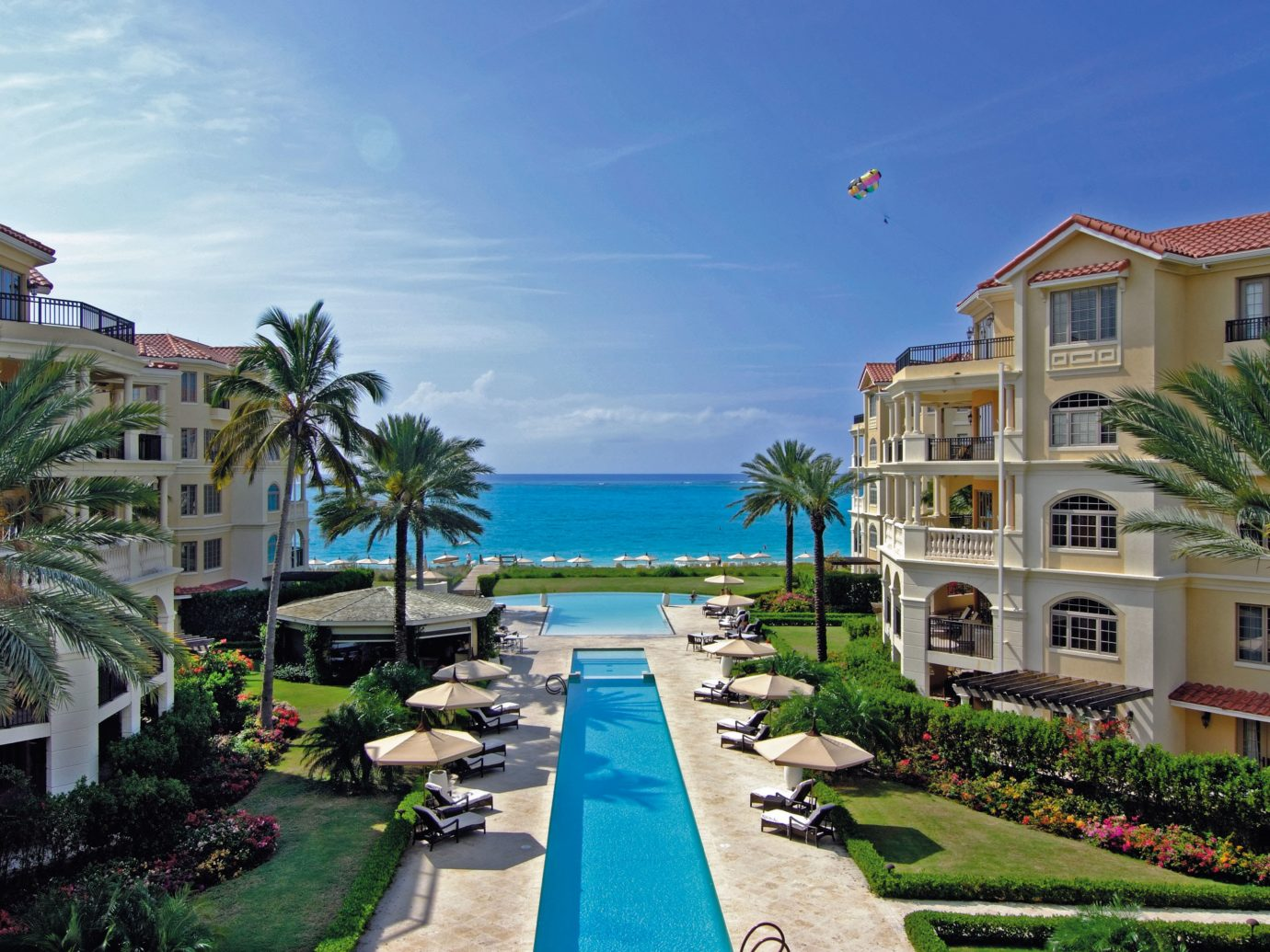 Beachfront Buildings Grounds Hotels Pool Resort Scenic views Trip Ideas outdoor sky house property Town vacation estate condominium residential area neighbourhood lawn walkway home Village plant caribbean Beach real estate bay marina Sea Garden palm