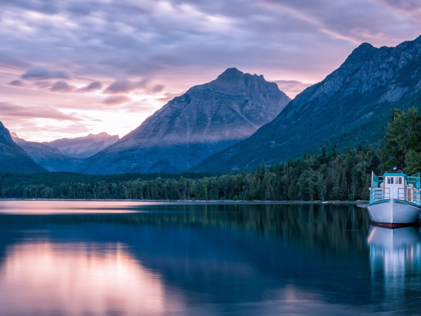 Hotels Lakes + Rivers National Parks Outdoors + Adventure Trip Ideas mountain water sky outdoor mountainous landforms Nature Boat reflection Lake landform wilderness mountain range body of water fjord cloud loch morning canyon landscape glacial landform alps reservoir dusk surrounded distance