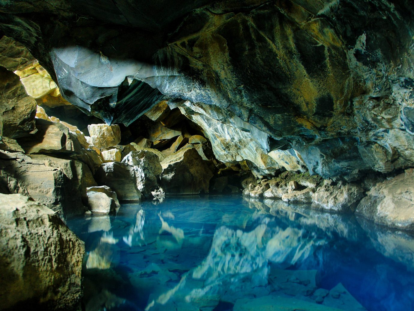 Offbeat rock water Nature outdoor cave formation underground lake watercourse coastal and oceanic landforms caving reflection fluvial landforms of streams geology sea cave Waterfall stream stone