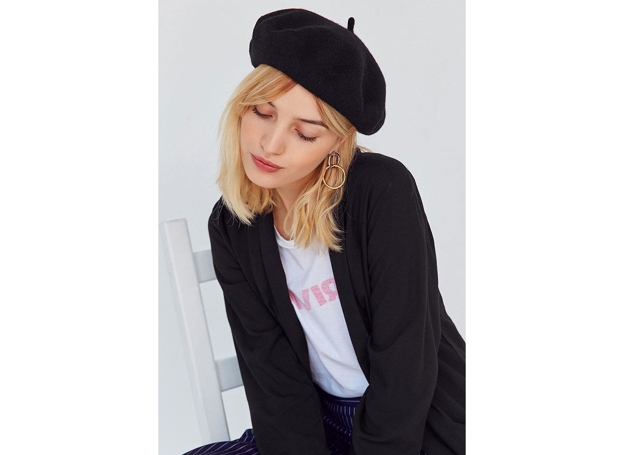 Travel Shop Travel Trends person woman clothing cap headgear wearing beanie outerwear hat knit cap jacket suit sleeve dressed