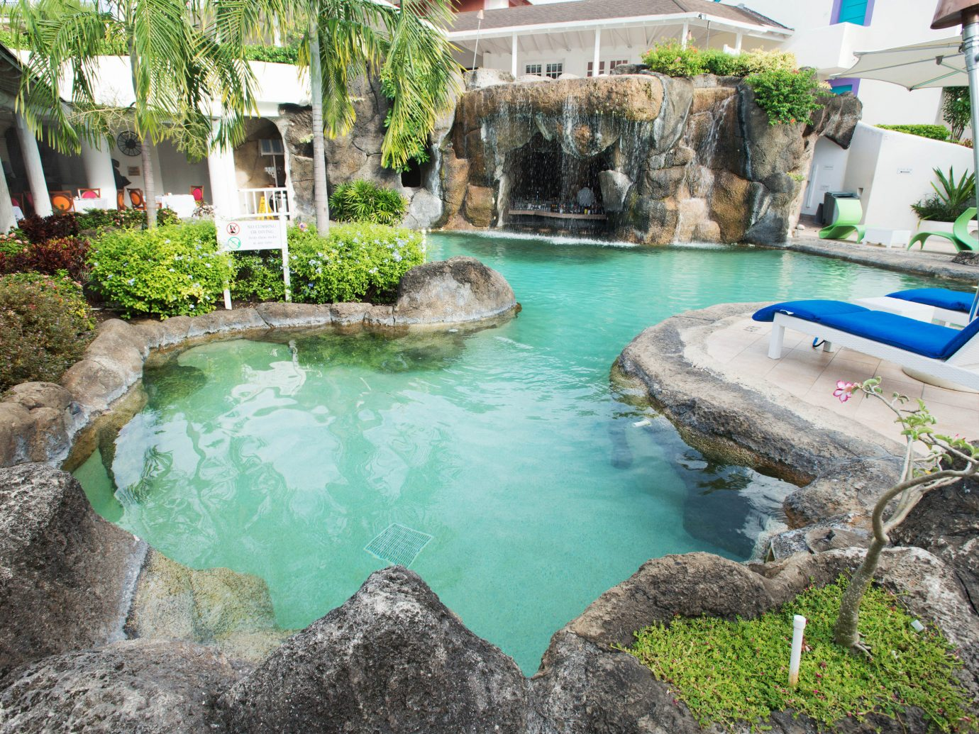 All-Inclusive Resorts Hotels building outdoor rock swimming pool property house pond backyard Nature estate Pool Garden Resort water feature fish pond stone