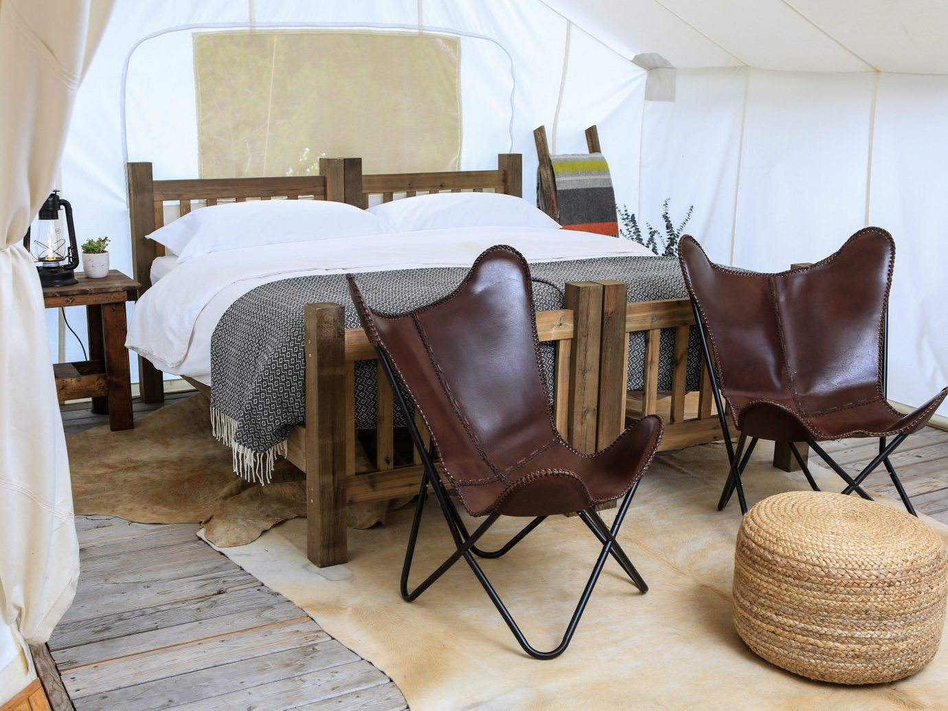 Glamping Hotels Outdoors + Adventure Trip Ideas indoor floor wall chair room property Living furniture living room interior design home table cottage Suite wood Villa estate bed