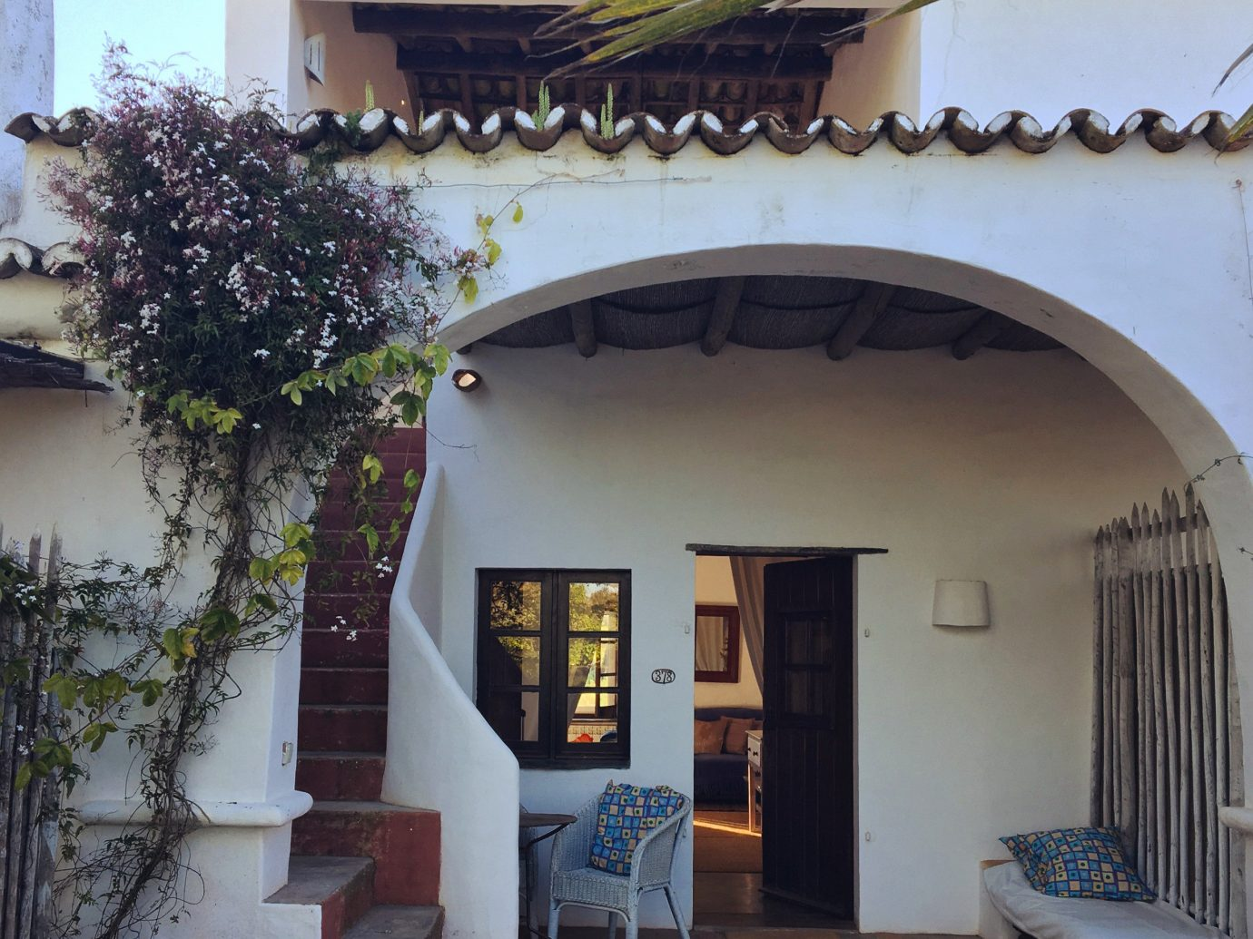 Hotels property outdoor house home real estate facade building hacienda Villa estate Courtyard window outdoor structure apartment old furniture stone arch several