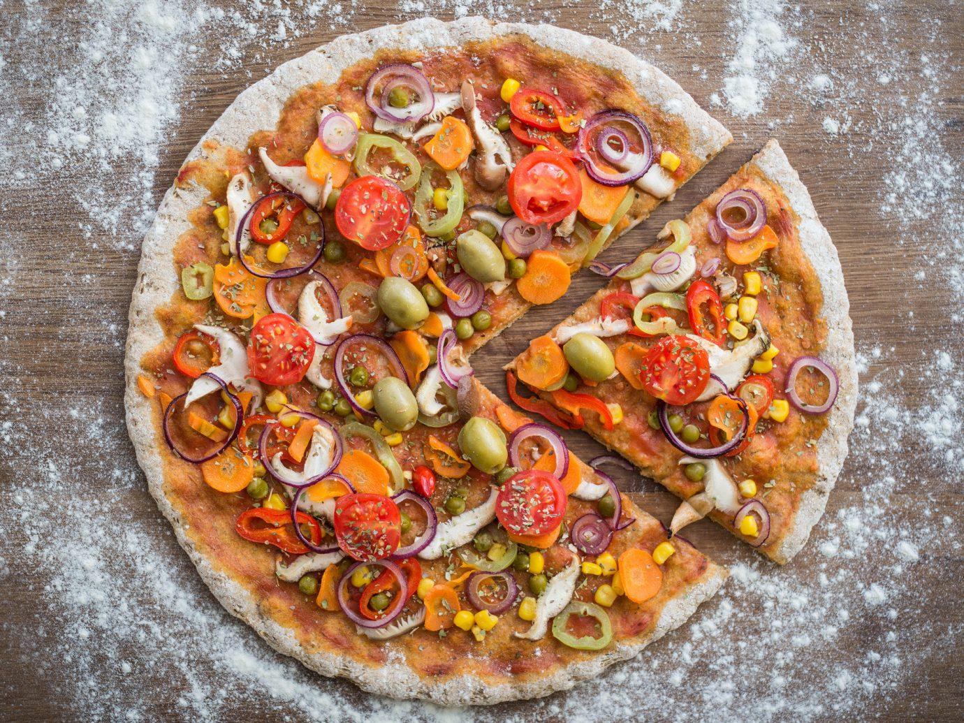 Family Travel Food + Drink Trip Ideas Weekend Getaways food dish pizza cuisine italian food produce european food vegetable toppings sliced