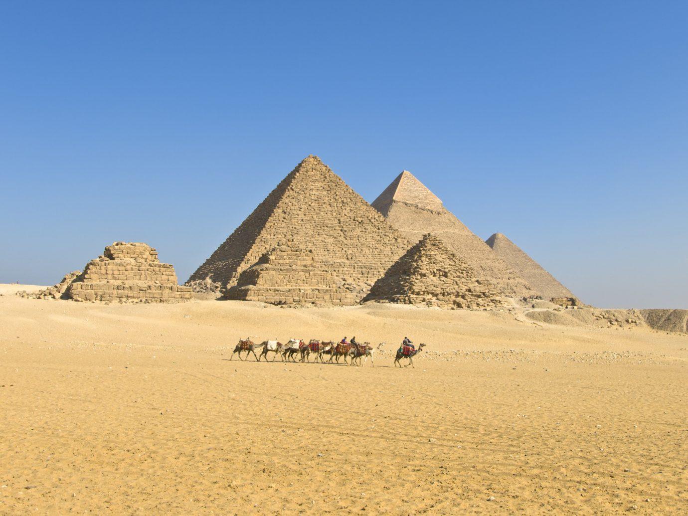 Hotels sky outdoor pyramid monument Nature ecosystem badlands landscape plateau wadi dune day sand highland