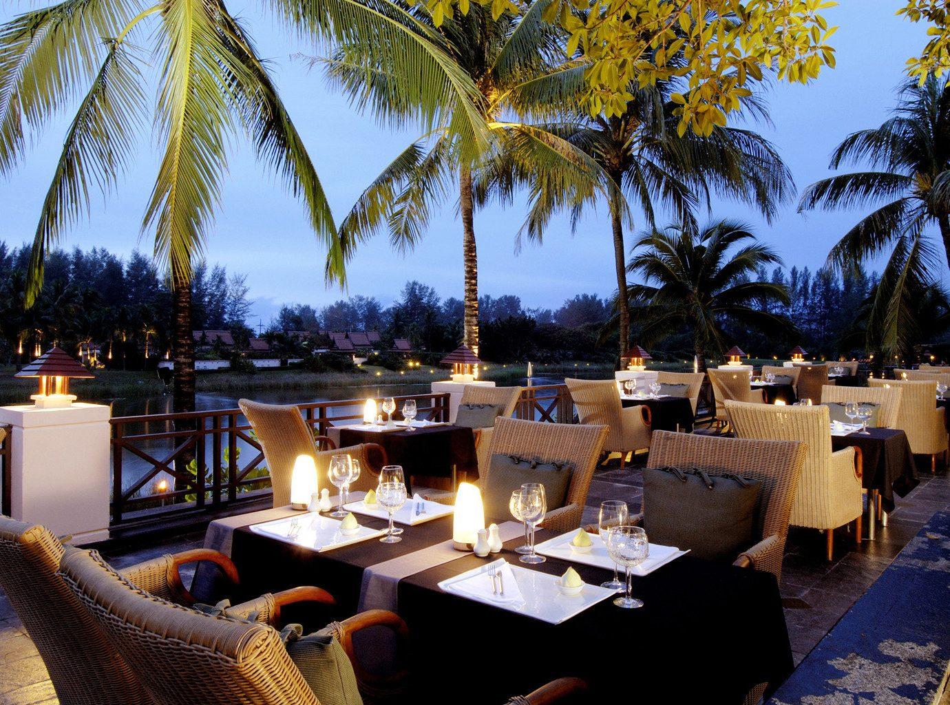 Beachfront Dining Drink Eat Honeymoon Hotels Luxury Romantic Wellness tree outdoor palm Resort restaurant estate meal