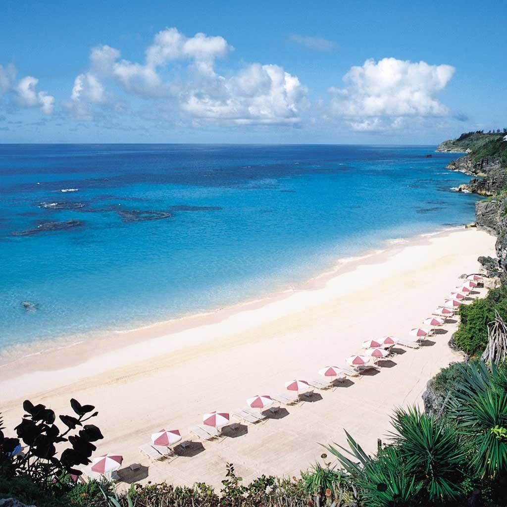 Beach Beachfront Hip Hotels Lounge Luxury Ocean water sky outdoor Nature shore body of water Sea Coast vacation caribbean people sand bay cape wind wave tropics wave reef sandy day