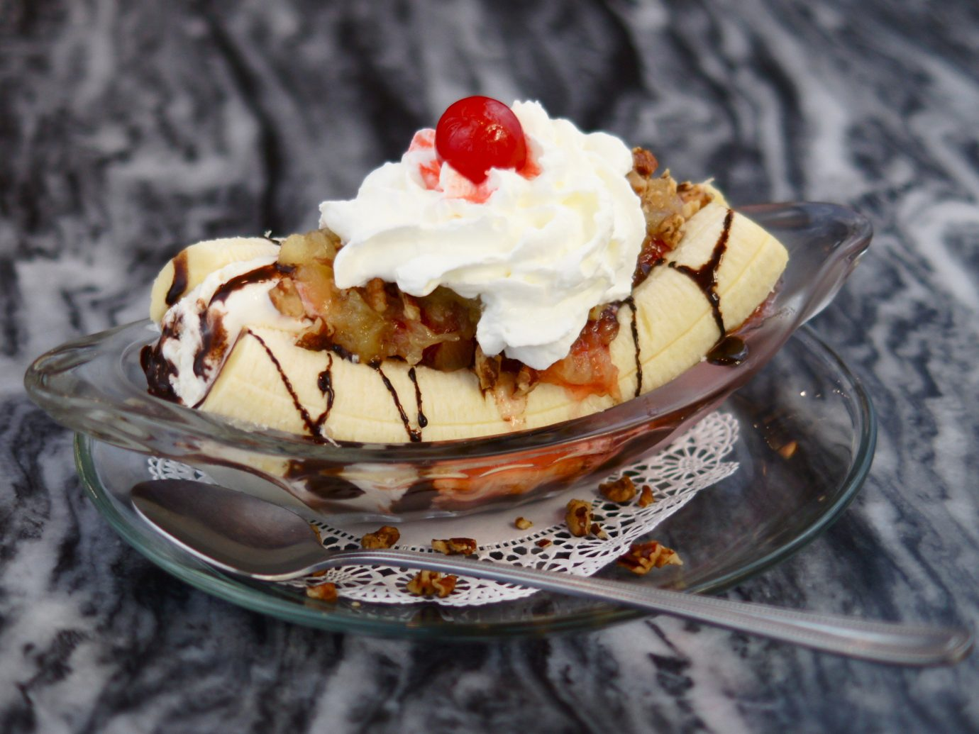 Food + Drink cake food dessert cream ice cream piece sundae frozen dessert whipped cream ice dairy product dish dame blanche slice toppings flavor pudding