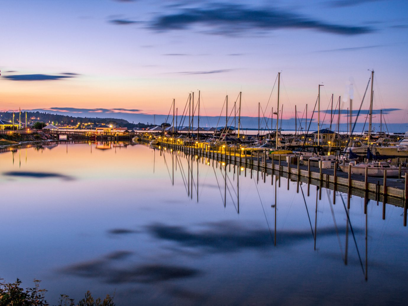 Trip Ideas outdoor sky water scene reflection shore body of water sunrise Sea Sunset dawn horizon evening dusk dock morning cloud marina Harbor Lake docked bay line lined several day