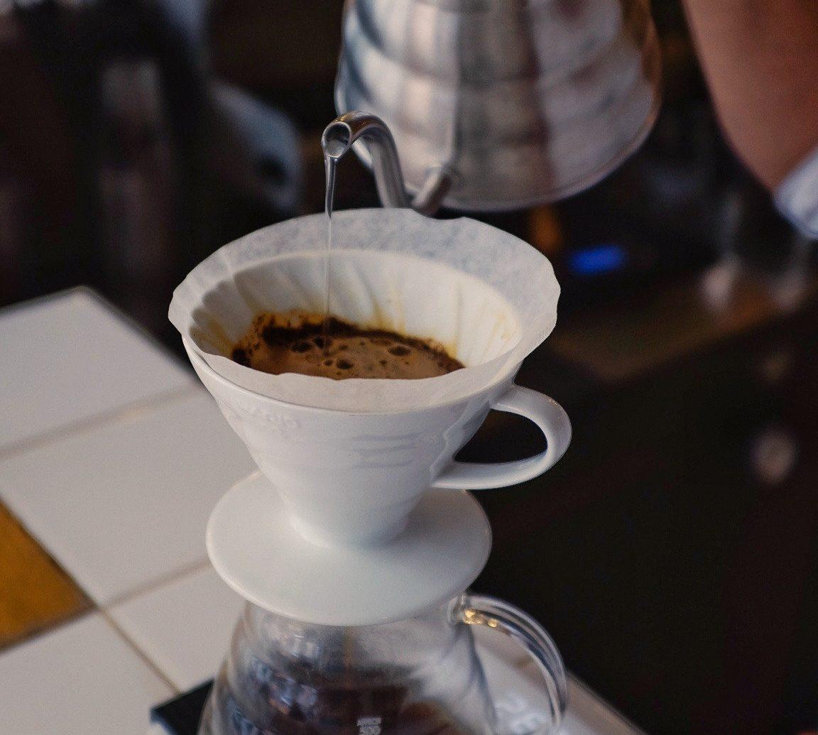 Food + Drink cup coffee person indoor Drink espresso food coffee cup tableware flavor mocaccino turkish coffee tea café wiener melange cappuccino breakfast meal