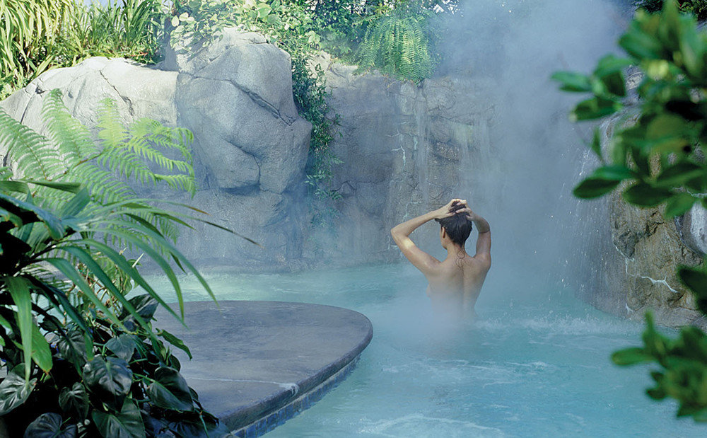 Health + Wellness Hotels Spa Retreats tree outdoor water green vacation water feature Waterfall Jungle tropics swimming pool rainforest flower spring