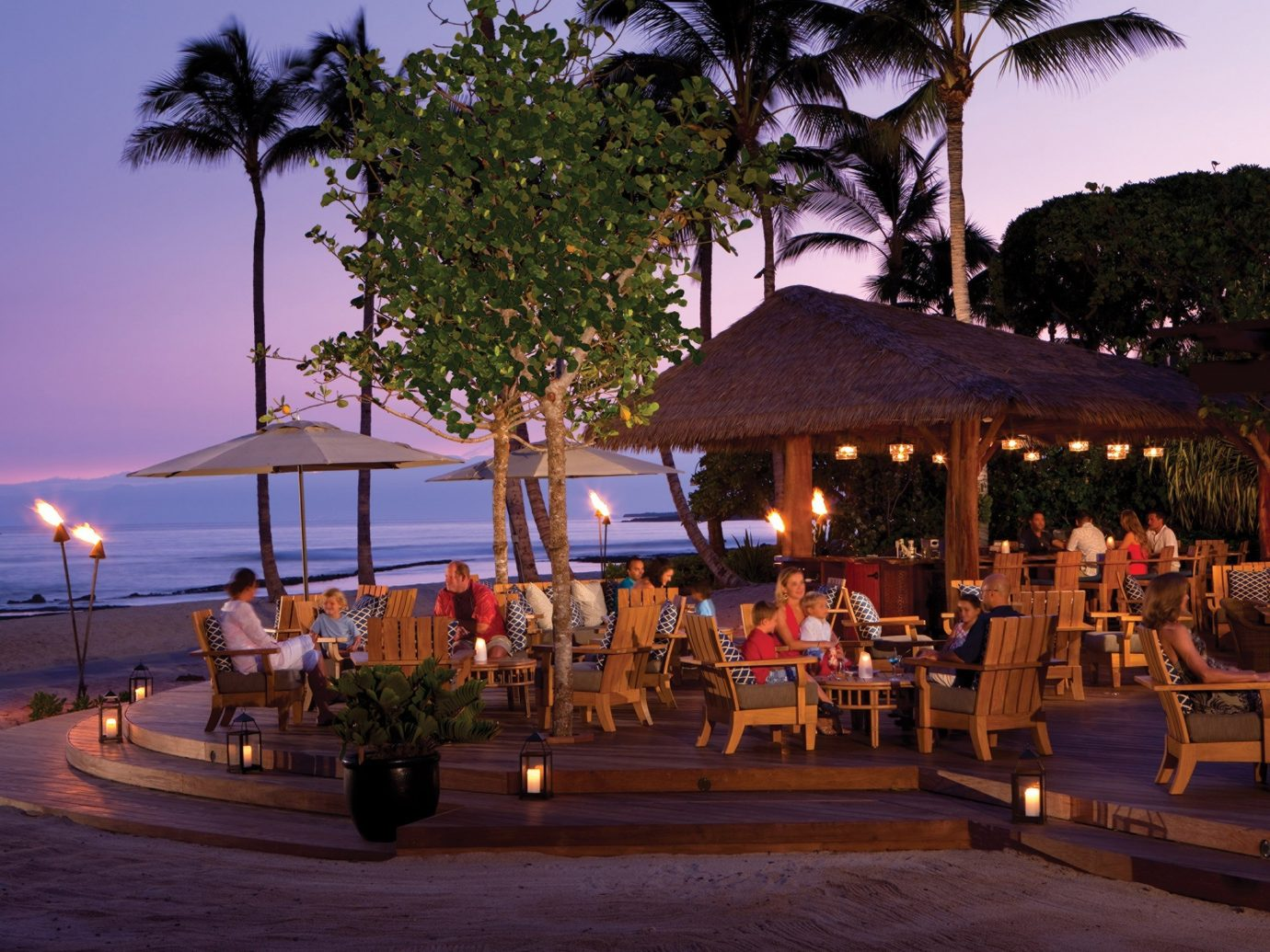 Hotels outdoor sky tree Resort vacation people evening Beach restaurant group arecales several