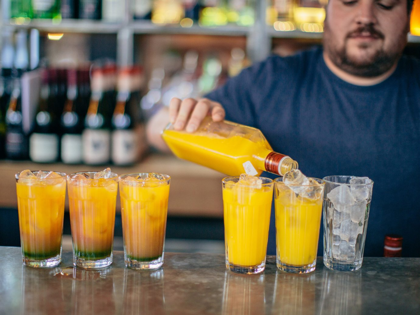 Budget Hotels London cup table Drink person indoor alcoholic beverage food cocktail alcohol drinking non alcoholic beverage distilled beverage beverage beer mai tai Bar liqueur orange fruit drink