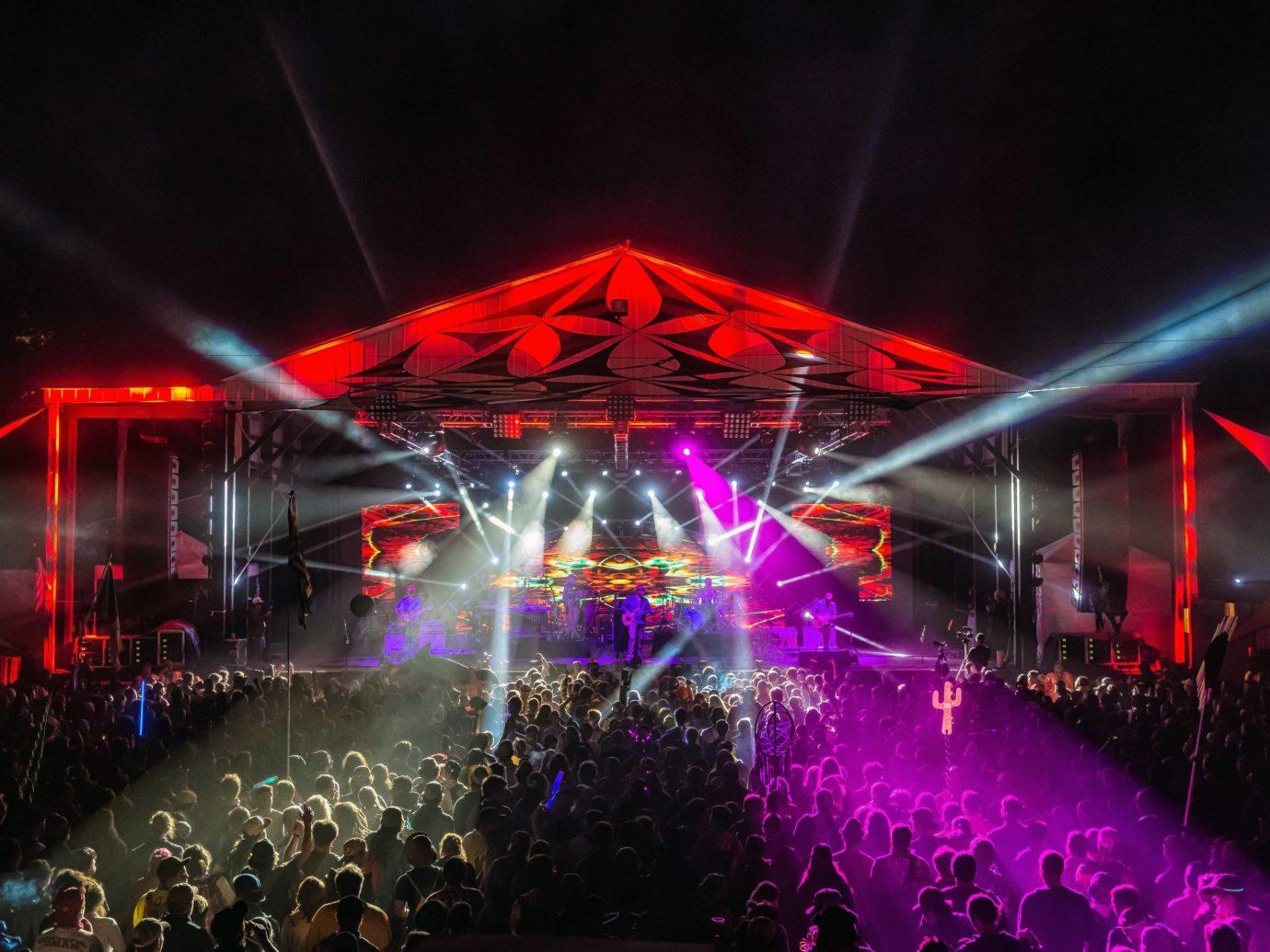 Arts + Culture performance rock concert night outdoor scene stage performing arts nightclub Entertainment concert Music music venue musical theatre light disco laser
