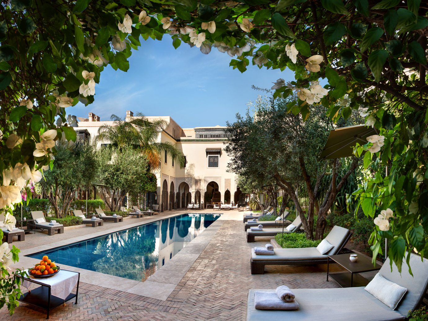 Hotels tree outdoor property estate swimming pool building Resort house plant vacation Villa backyard home mansion Courtyard Garden cottage furniture lined shade stone