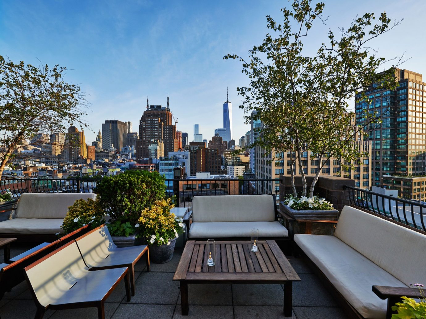 Hotels tree sky outdoor City neighbourhood condominium urban area landmark plaza human settlement Downtown Architecture residential area park estate vacation cityscape waterway skyline real estate town square home outdoor structure apartment