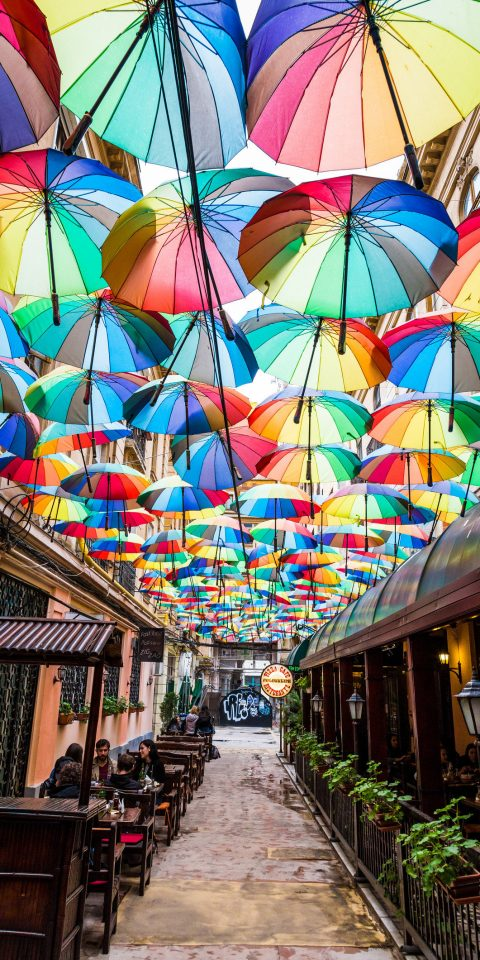 Travel Tips Trip Ideas umbrella accessory color rain outdoor colorful window art glass colored symmetry lined