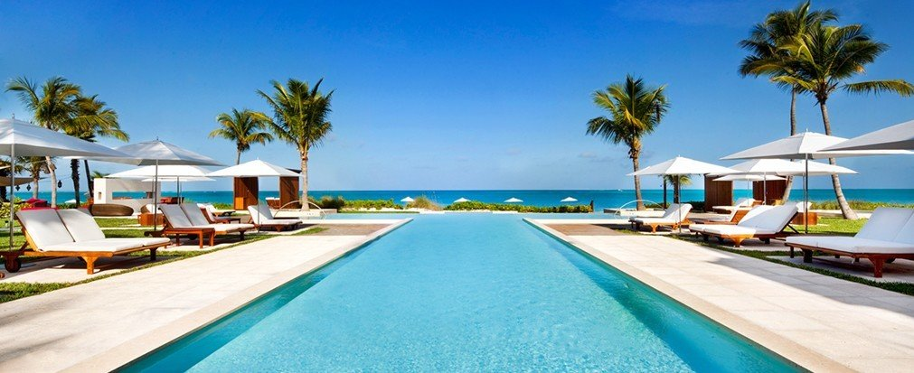 Travel Tips sky outdoor tree palm Beach swimming pool property Resort leisure caribbean vacation Pool estate Villa real estate blue resort town bay lined Lagoon marina Deck swimming shore shade sandy