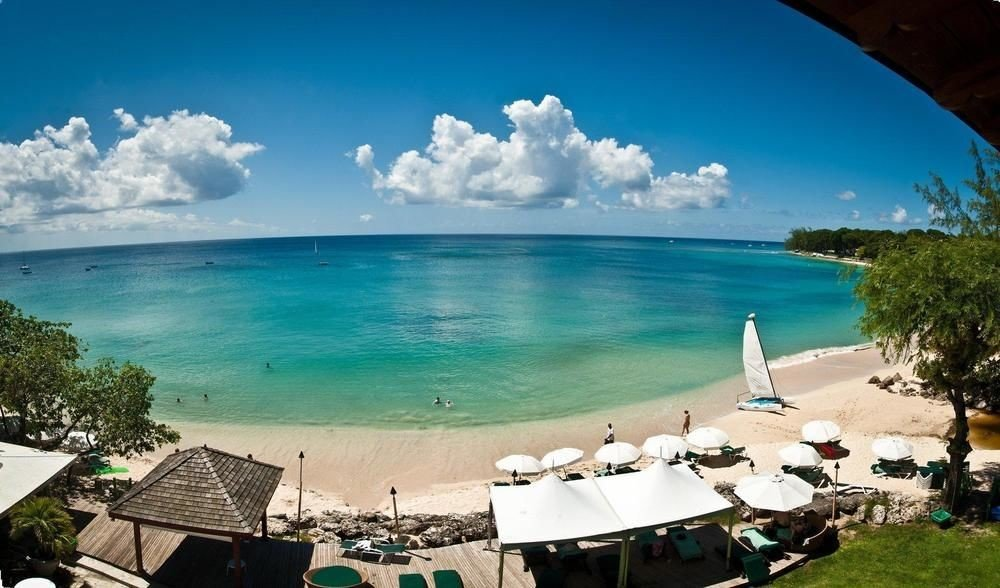 All-Inclusive Resorts Hotels water sky outdoor Nature body of water Beach swimming pool Sea Ocean caribbean vacation shore bay Lagoon Resort overlooking Island day