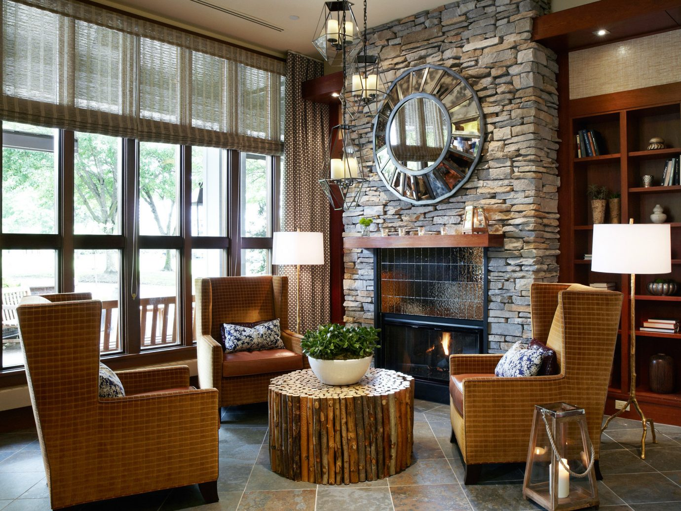 Boutique Hotels Drink Fireplace Hotels Lobby Lounge Luxury Travel Modern Scenic views Waterfront floor indoor Living room dining room chair window property living room estate ceiling home interior design hardwood cabinetry real estate condominium wood Design window covering furniture area
