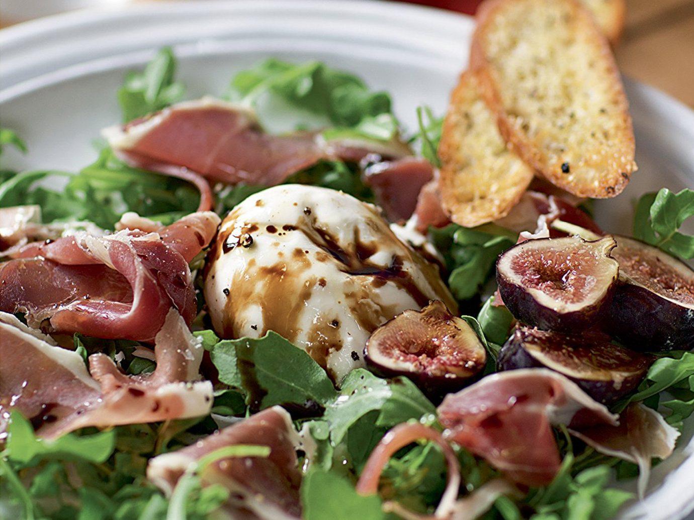 Food + Drink food plate dish salad meat cuisine meal produce caesar salad lunch vegetable