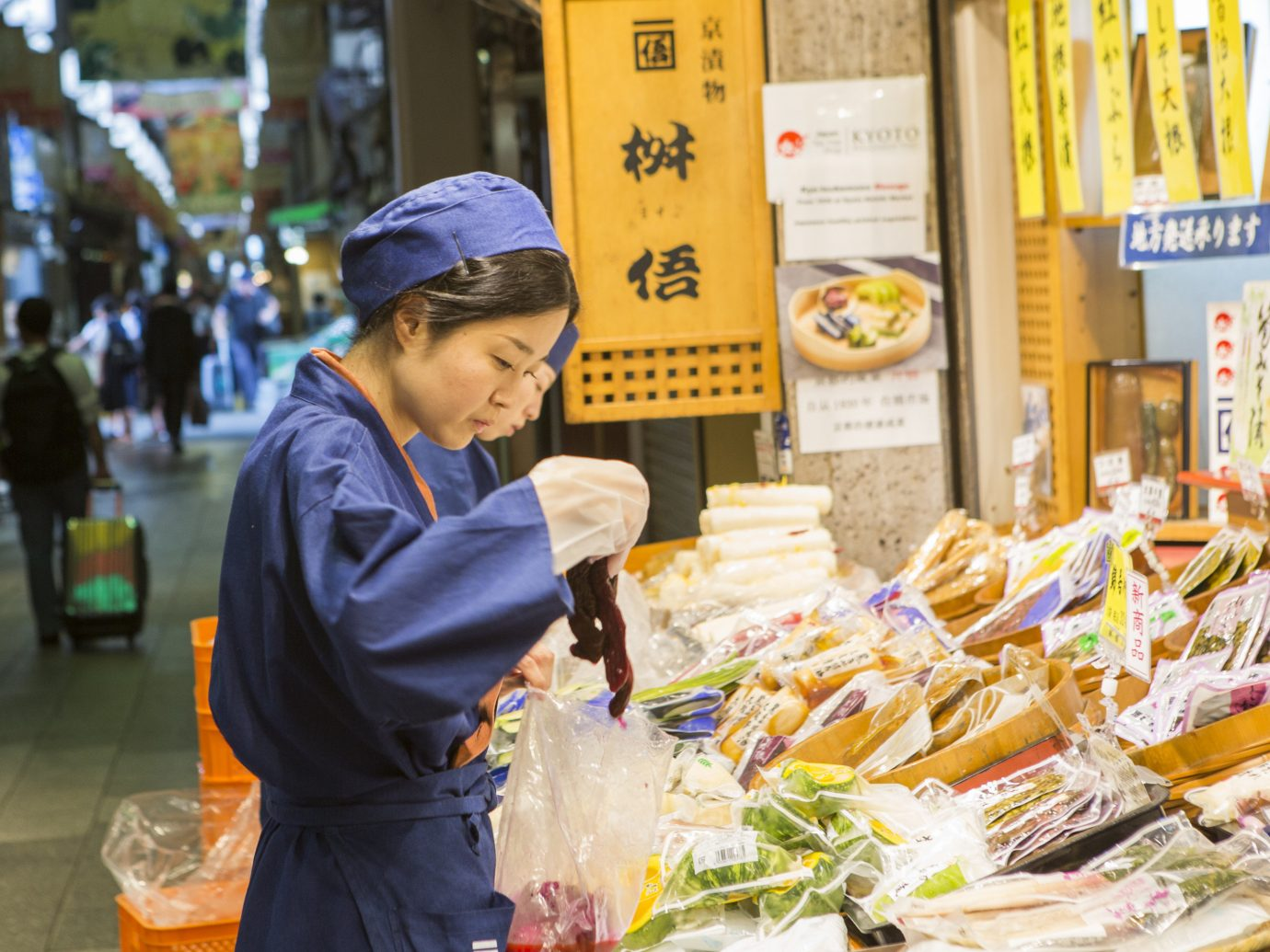 Beauty Health + Wellness Japan Kyoto San Francisco Travel Tips person market food vendor marketplace public space produce street food selling shopkeeper bazaar street stall local food snack food