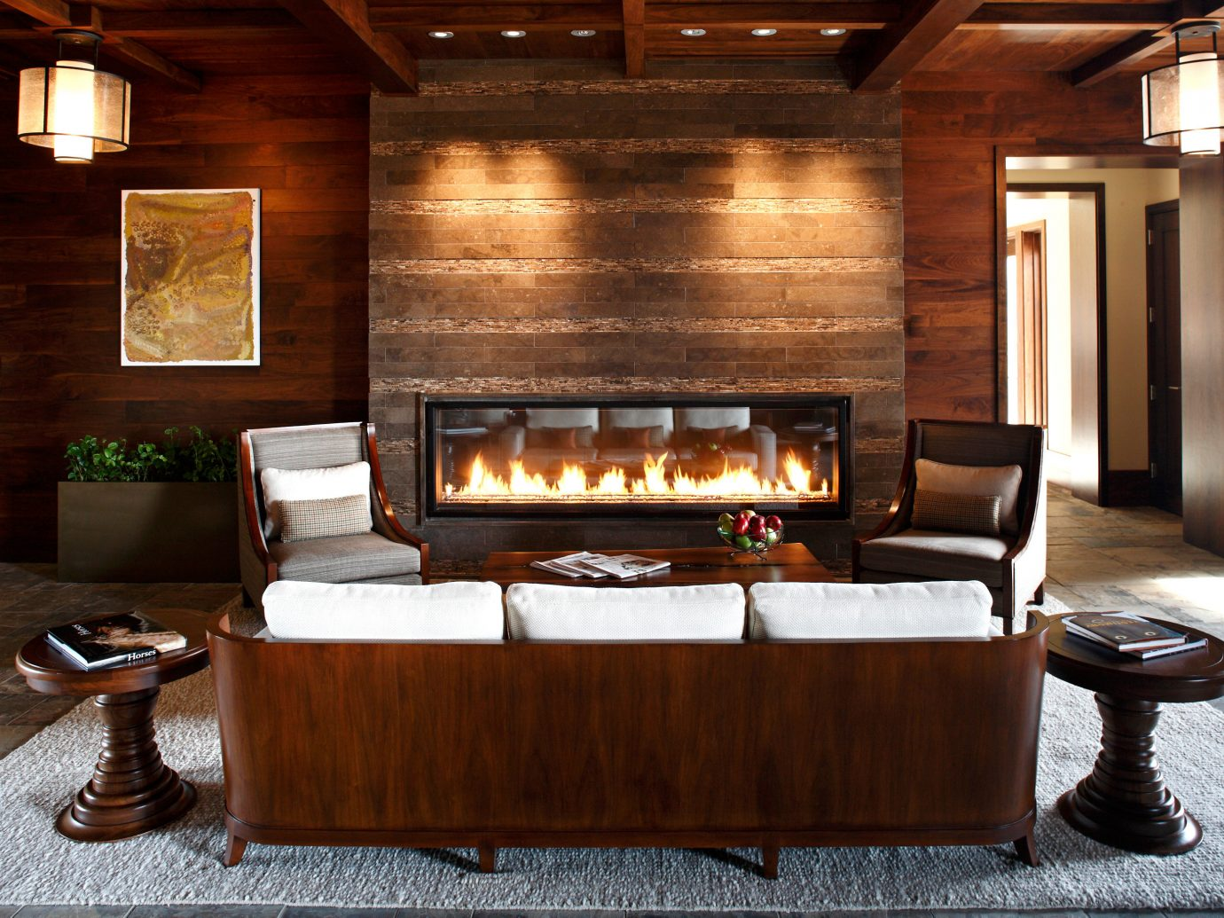 Fireplace Hotels Living Lounge Modern Romantic indoor floor man made object hearth room living room hardwood ceiling wood wooden home interior design lighting furniture cabinetry estate wood flooring Design cuisine cottage area stone