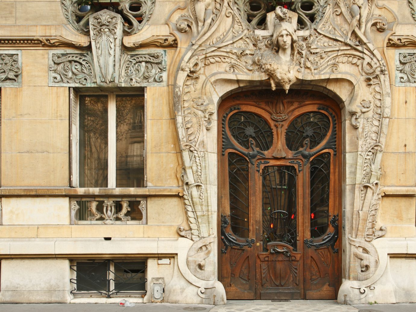Offbeat outdoor structure building Architecture house facade ancient history palace carving art column door wood window place of worship sculpture temple arch history synagogue Church old stone