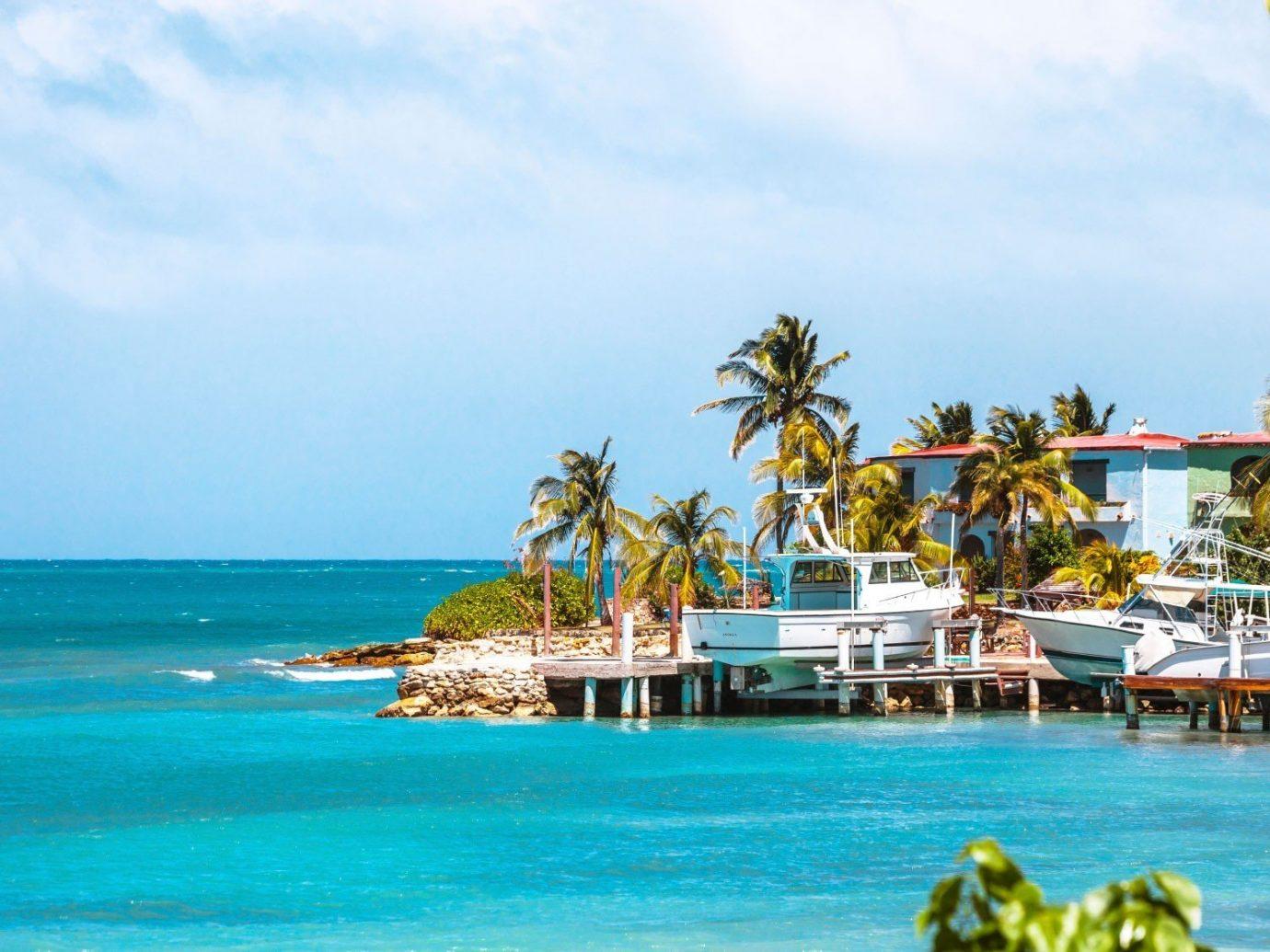 Deals sky water outdoor Beach leisure caribbean Sea vacation Resort Ocean bay Island tropics Lagoon Coast shore swimming