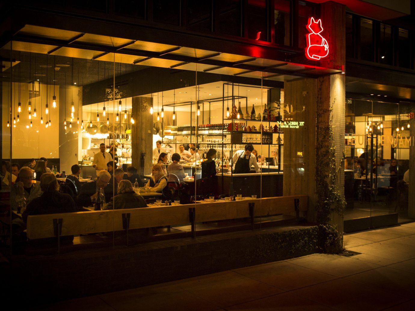 Food + Drink Travel Tips night lighting restaurant display window City window darkness