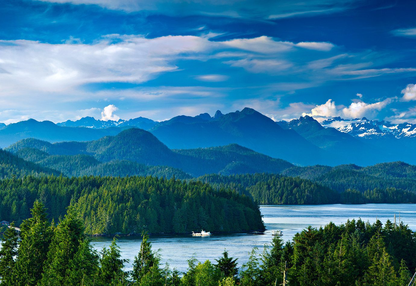 National Parks Outdoors + Adventure Trip Ideas water mountain Lake tree sky outdoor Nature mount scenery wilderness River Boat nature reserve national park crater lake highland water resources mountain range hill station daytime fjord reflection biome glacial lake cloud computer wallpaper landscape background fell cumulus Forest sound watercourse glacial landform bank surrounded beautiful overlooking pond clouds distance land hillside