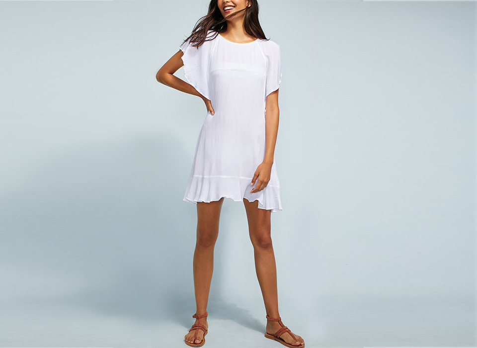 Travel Tips tennis woman person clothing white standing fashion model shoulder day dress court joint dress player sleeve neck female waist posing