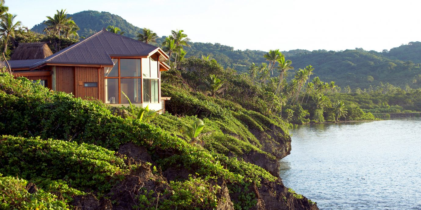 All-Inclusive Resorts Bedroom Boutique Hotels Deck Drink Eat Elegant Hotels Pool Romance Scenic views Terrace Waterfront outdoor tree water mountain house River Coast rural area green plant Lake surrounded bushes hillside lush