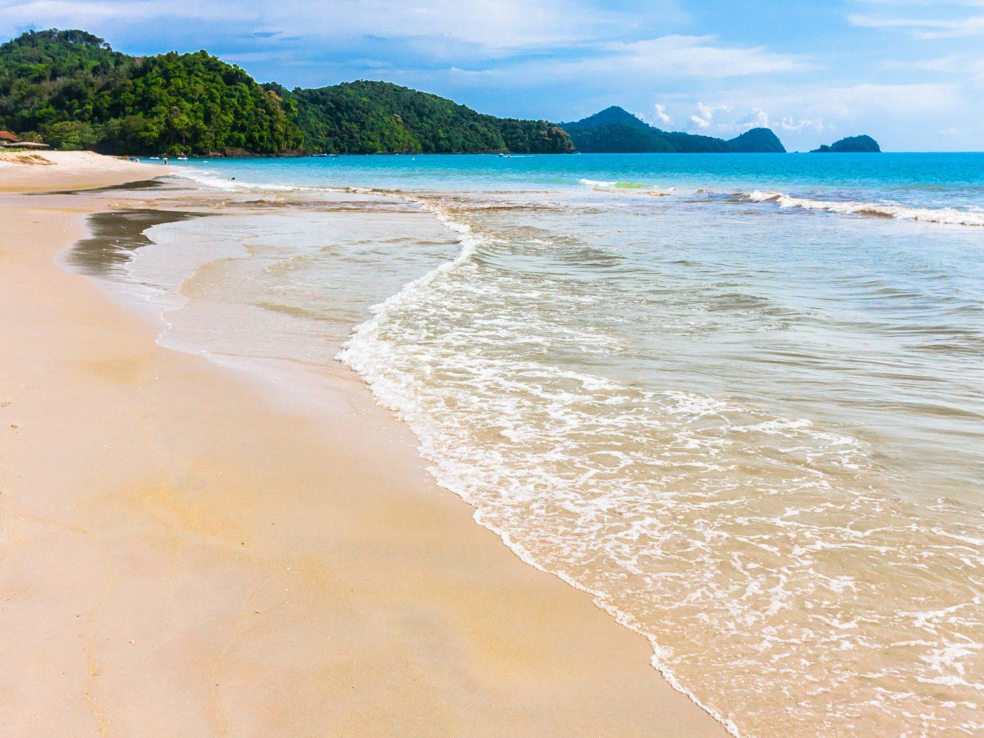 Romantic Getaways sky outdoor water Beach Nature Sea coastal and oceanic landforms shore body of water Coast Ocean wave sand wind wave caribbean bay vacation tropics horizon cape tide sandy day