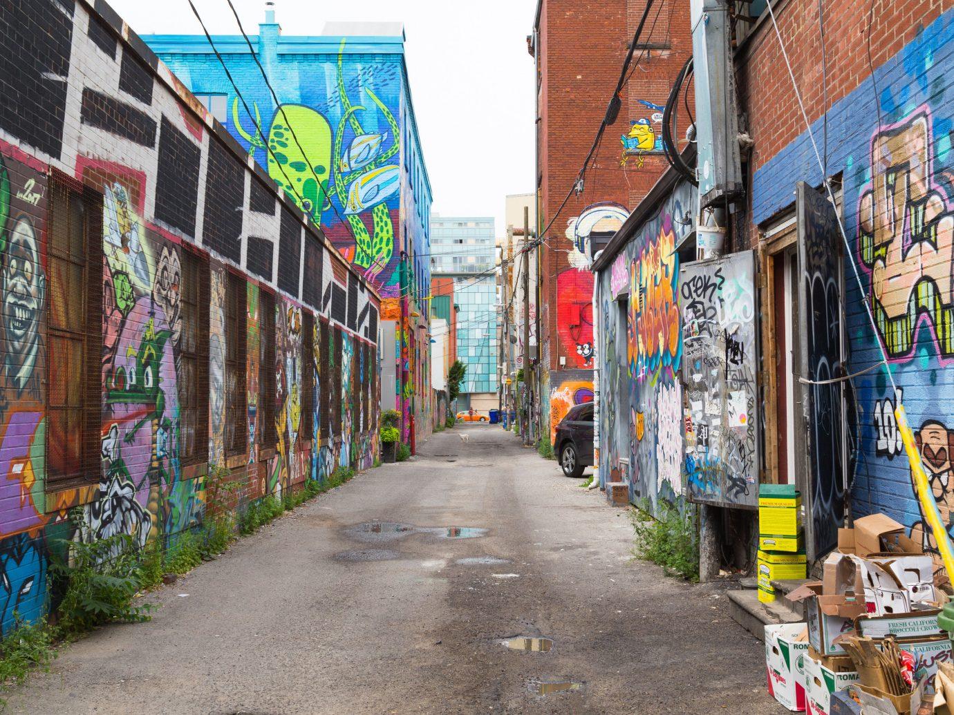 Canada Montreal Toronto Trip Ideas scene way sidewalk outdoor neighbourhood alley Town street urban area road City graffiti art lane mural metropolis street art pedestrian bazaar colorful