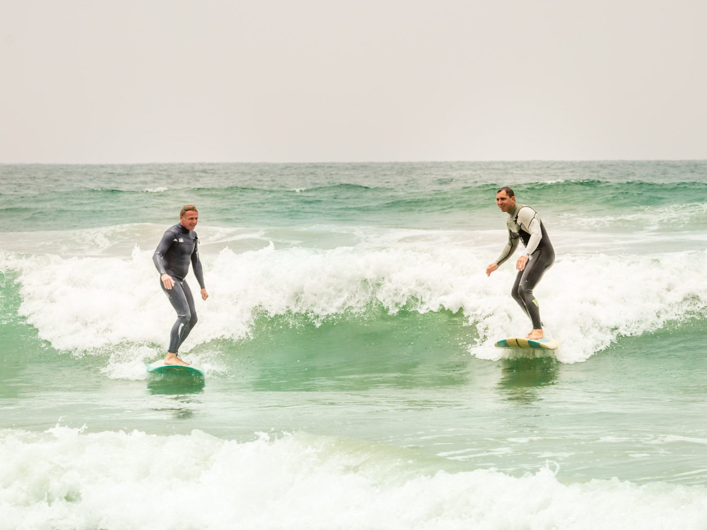 Hotels water surfing water sport wave sky outdoor riding Sport Ocean man sports wind wave boardsport surfboard surface water sports Sea surfing equipment and supplies skimboarding Beach extreme sport Coast individual sports