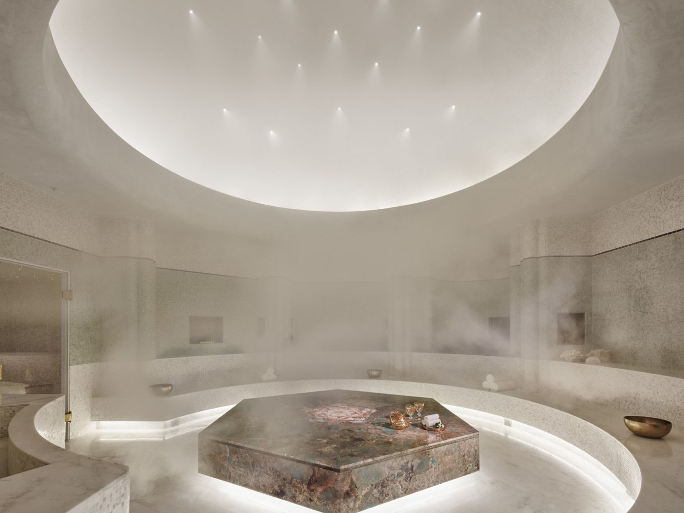 ambient lighting chic clean Health + Wellness Hotels Luxury marble private relaxation sauna Spa Spa Retreats steam room white indoor wall ceiling room floor daylighting bathtub lighting plumbing fixture bathroom swimming pool interior design shape Design jacuzzi table porcelain
