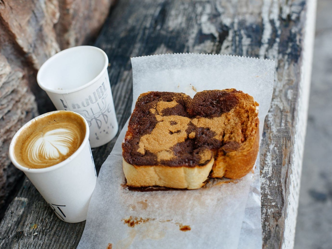 Food + Drink cup coffee ground food outdoor piece breakfast meal dish dessert chocolate baking pastry coconut snack food baked goods chocolate brownie flavor produce sweetness