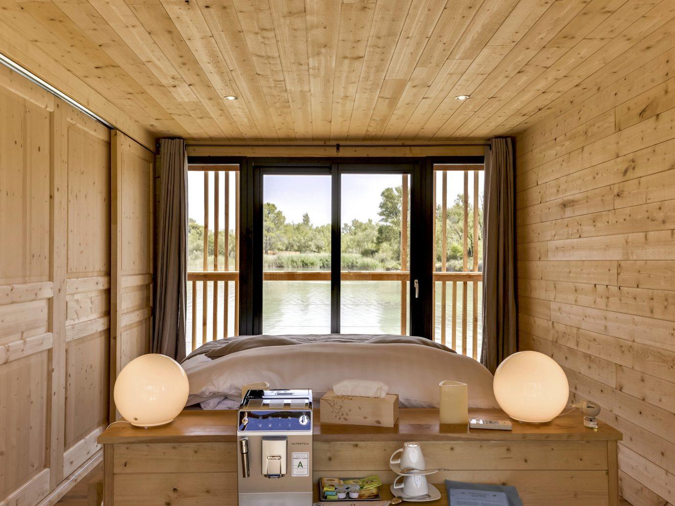 Hotels News Offbeat indoor room ceiling Architecture house wood home interior design real estate window daylighting log cabin floor wood stain wood flooring estate hardwood furniture