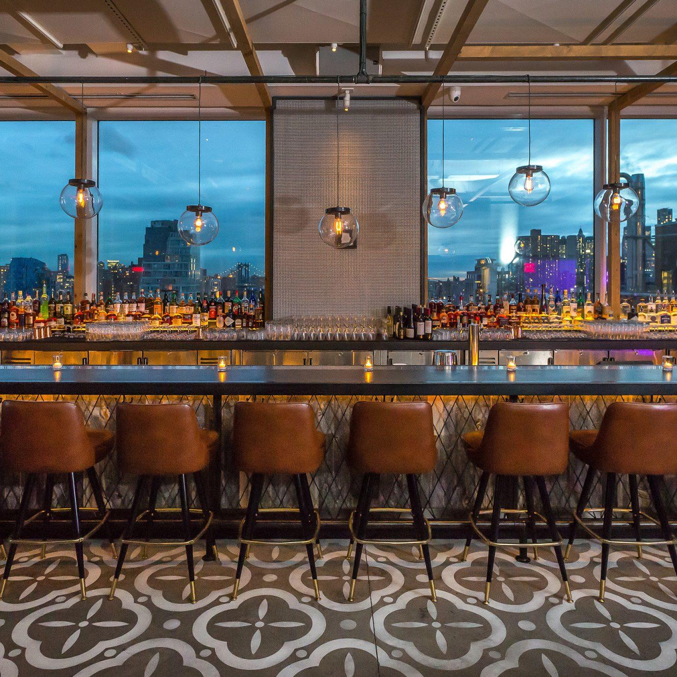 Food + Drink table floor indoor chair ceiling restaurant estate meal Resort function hall interior design Bar several furniture dining room
