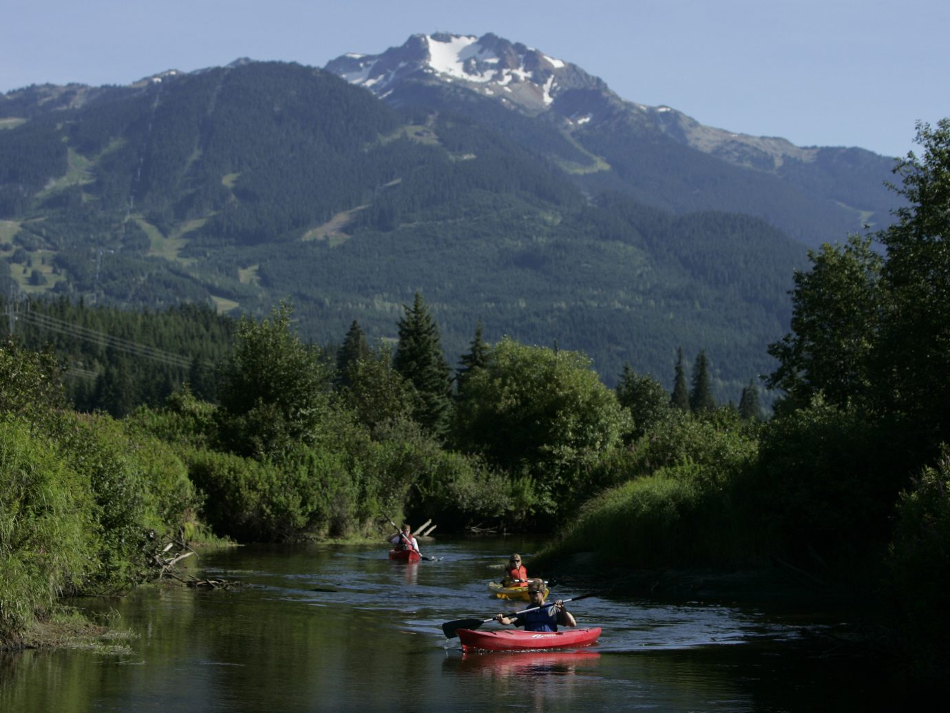 Hotels mountain outdoor tree water sky Boat River Lake vehicle boating wilderness Nature kayak kayaking canoe watercraft paddle sports equipment traveling surrounded Forest wooded