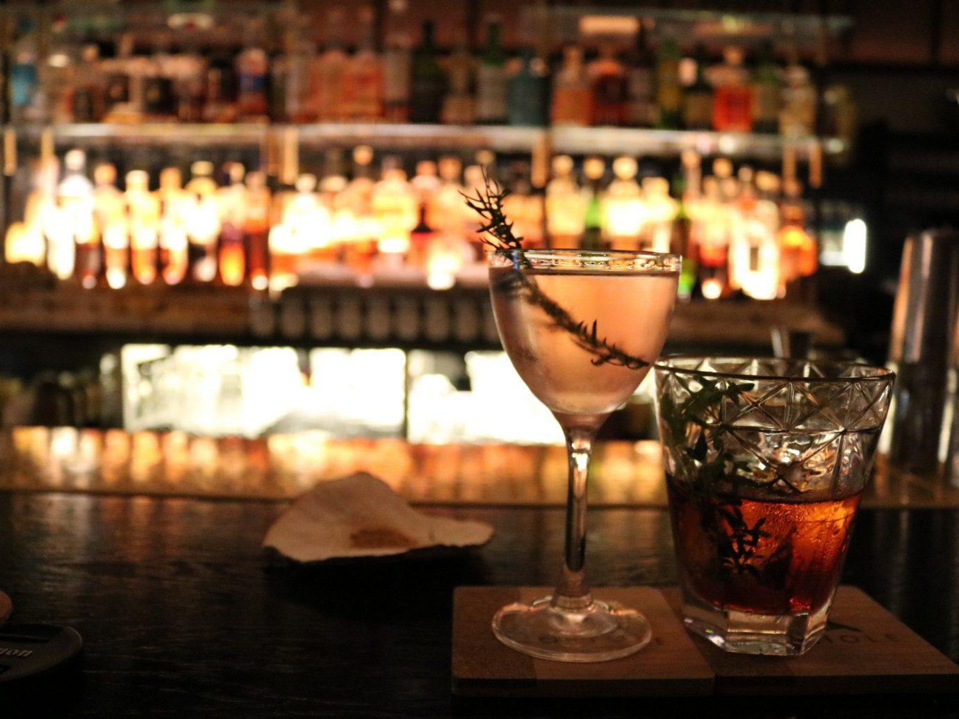 Budget Trip Ideas table indoor wine alcoholic beverage Bar Drink restaurant lighting cocktail