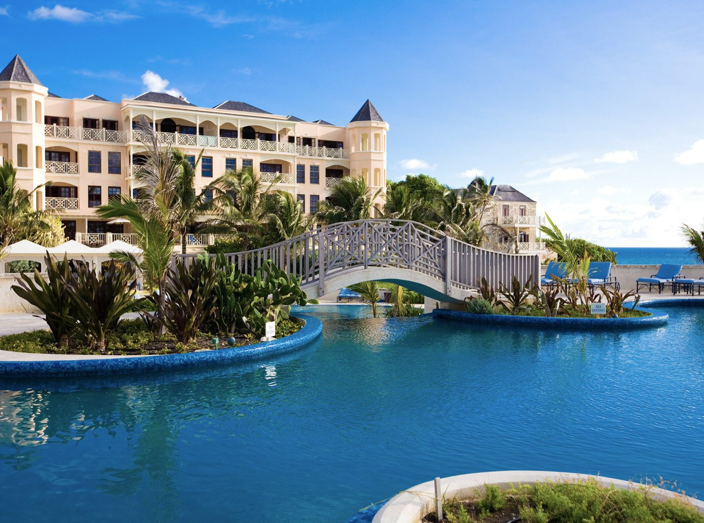 All-Inclusive Resorts Hotels water outdoor sky Boat property leisure swimming pool Resort estate vacation resort town home Villa River palace condominium mansion Lake real estate Harbor bay Sea blue swimming surrounded