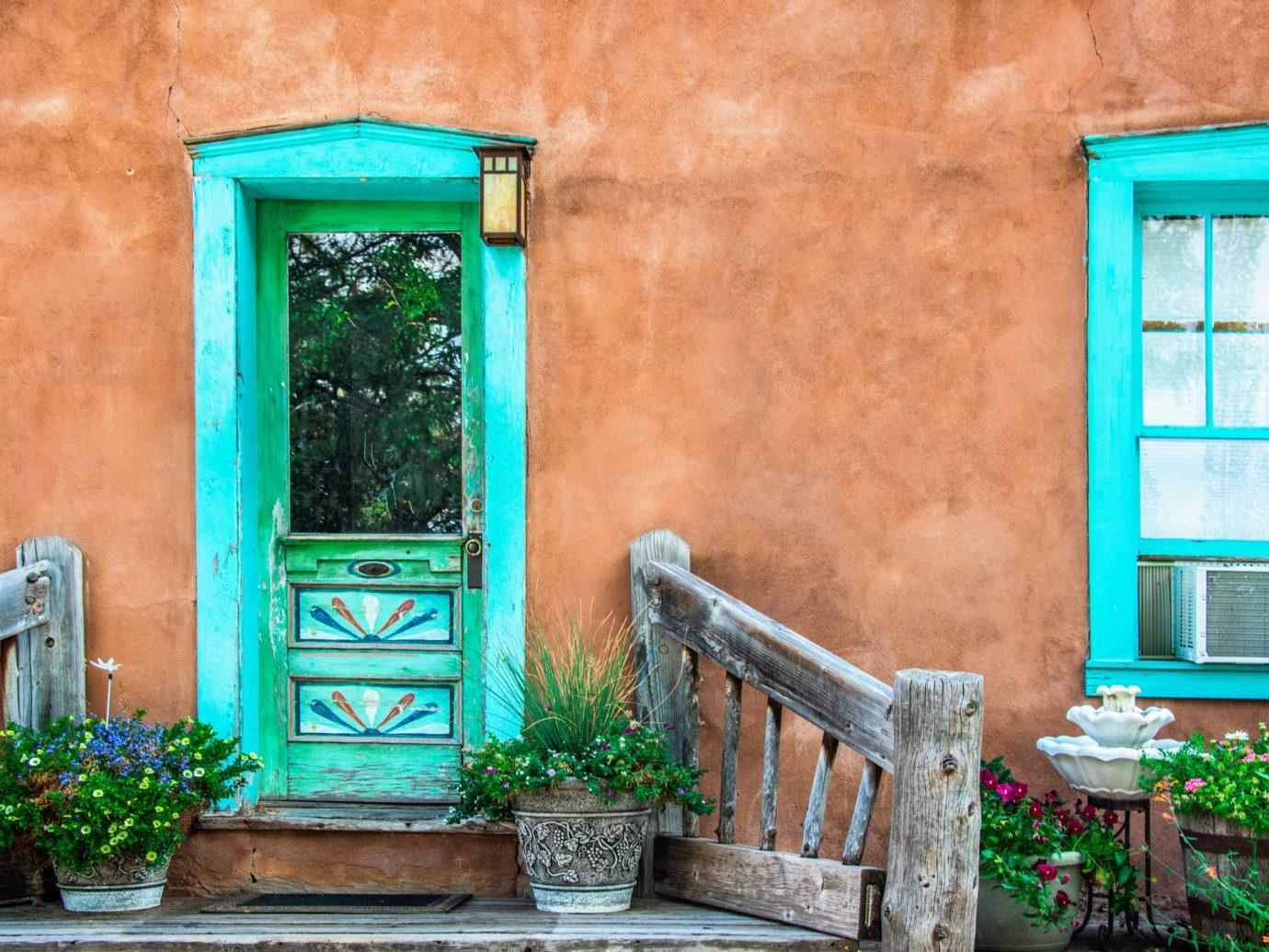Offbeat building outdoor color green blue house wall home window estate door porch interior design facade backyard Garden mansion cottage Courtyard old stone surrounded