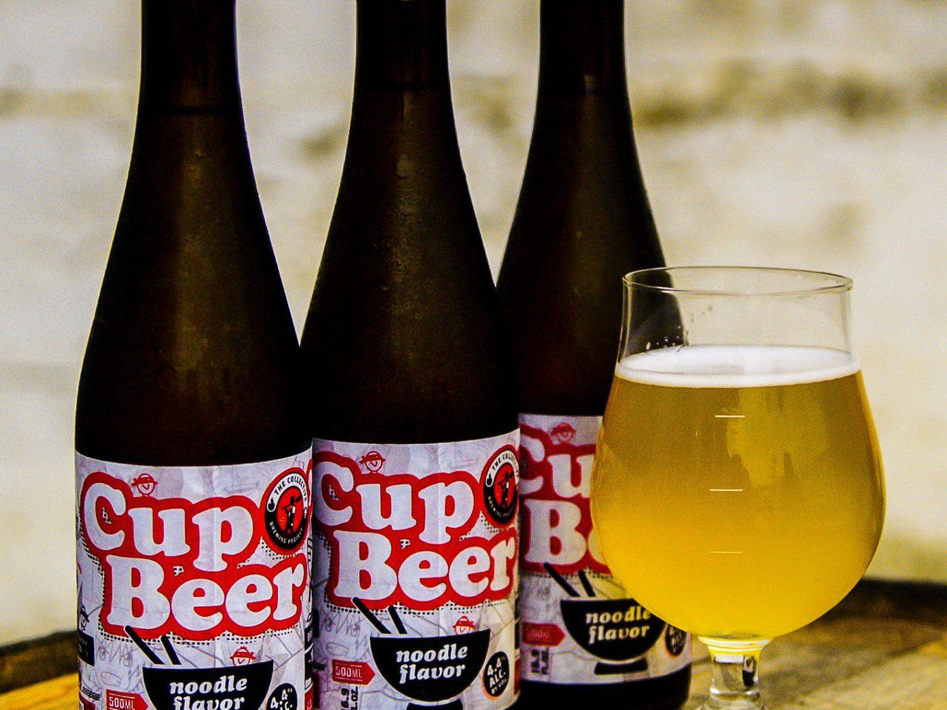 Offbeat bottle table wine indoor Drink beer alcoholic beverage glass bottle beer bottle ale pint us alcohol beverage
