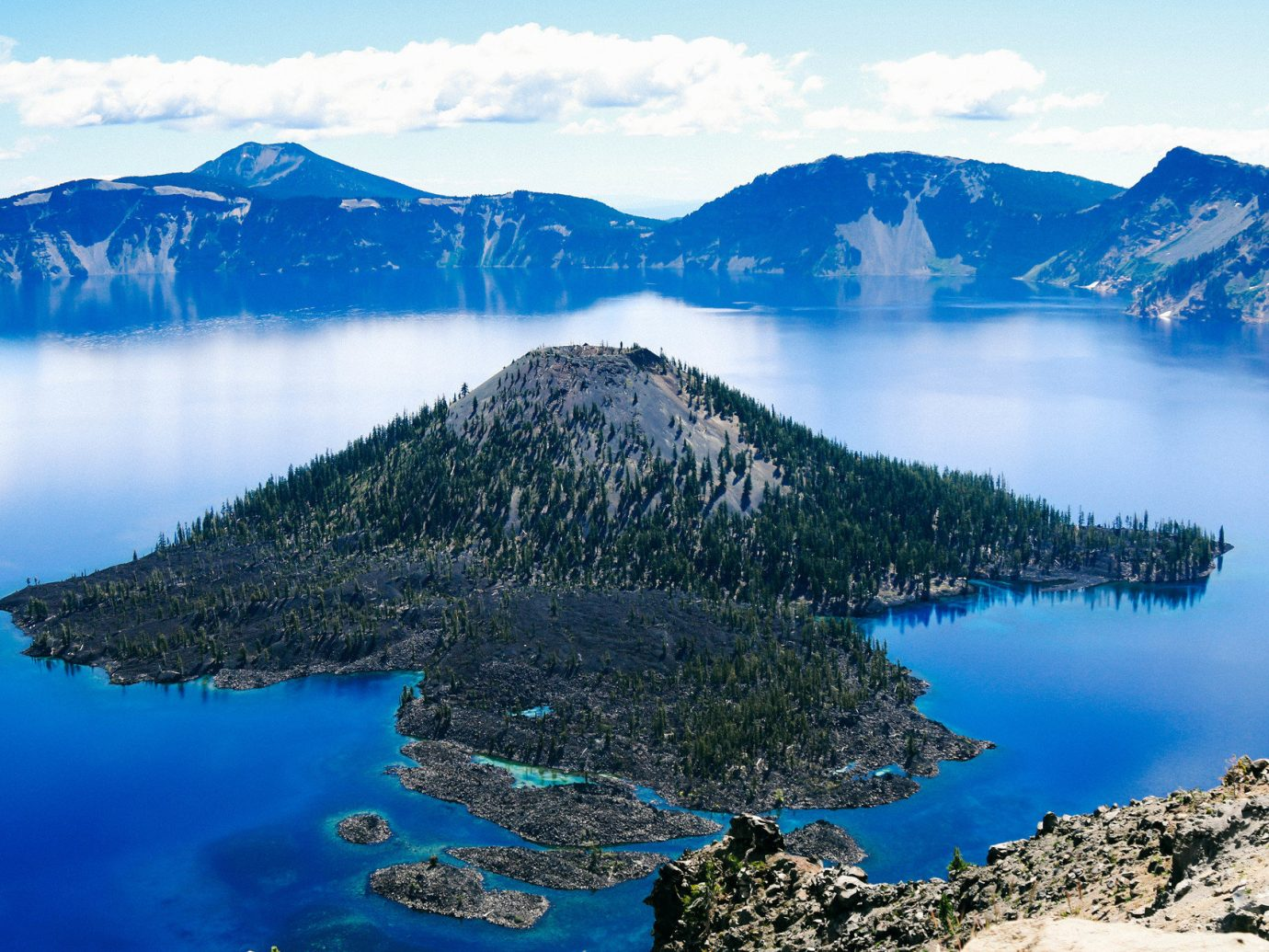 Jetsetter Guides Road Trips Trip Ideas sky mountain outdoor Nature water snow Lake landform geographical feature crater lake reflection loch mountain range fell fjord reservoir bay national park surrounded